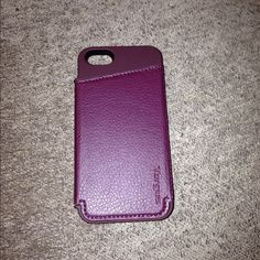 Targus Merlot iPhone 5 case with credit card slots This dark Merlot (purple) targus iPhone 5 case is also a wallet (please see picture for best description)! I did drop this case once so there is very small wear on two corners (please see pictures) other than that the case is in great condition! Targus Bags