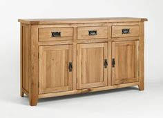 Westbury Oak Large Sideboard - Our Westbury Oak living and dining range is hand built using high-grade oak. Every piece within the Westbury Oak range is carefully made with dovetailed drawers and comes complete with solid oak drawer bases and cabinet backs. The Westbury Oak range has classically-styled metal handles, which offset the light oak timbers beautifully.