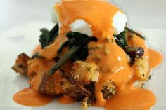 Poached Egg on top of Sourdough Sausage Stuffing Cake w/ Roasted Pepper Hollandaise