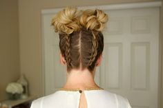 """Take the popular hairstyle """"Space Buns"""" to the next level with dutch braids! This hairstyle, original inspo here, is not only perfect for sweating it out at the gym but easily transitions for whatever you've got scheduled afterwards! Make the braiding easier by flipping your…"""