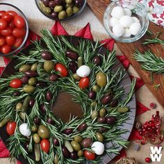 A holiday hack for your next party: Arrange rosemary into a wreath and decorate with olives and other antipasti for an instantly festive appetizer. Edible Centerpieces, Christmas Centerpieces, Xmas Decorations, Christmas Cookies, Christmas Holidays, Christmas Wreaths, White Christmas, Edible Flowers, Winter Solstice