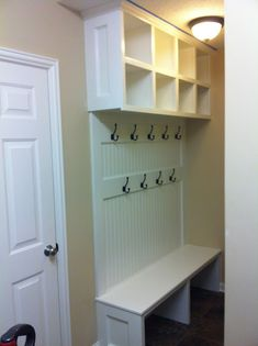 "This, with narrow ""wall"" on left side and floor to ceiling cabinets on right side"