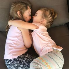 It looks cute but they are growling at each other and lovingly biting the others face. This sums up their relationship. #raisingdaughters #raisingarrows #amyrdunham #sahmlife #littlewomen #thatfloridalife #toddlermom #smartmamas #mombassador