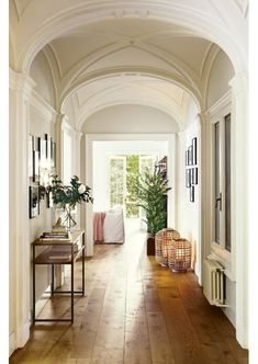The wide paneled wood floors and vaulted ceiling
