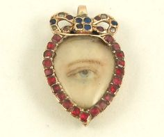 Eye miniature hand-painted on ivory Circa 1790 Light blue eye hand-painted on ivory, modified heart with garnet surround and bow. Antique Jewelry, Vintage Jewelry, Light Blue Eyes, Lovers Eyes, Miniature Portraits, Mourning Jewelry, Eye Jewelry, Eye Art, White Enamel