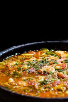 Moqueca,  Brazilian seafood stew, with shrimp, fish, coconut Milk...