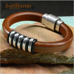 This doesn't really fit into the gemstone category, but here is a Regaliz Licorice Leather Bracelet by SunStones on Etsy, $35.00