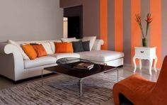 Living Room Decor! The wall, colored accents and decorative pillows are perfect!