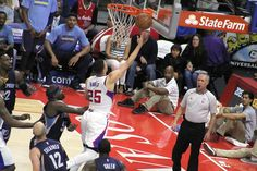 Austin Rivers goes to the basket as Memphis forward Zach Randolph becomes a bystander.