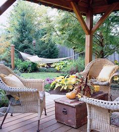 Add a Structure    Providing privacy from tall surrounding buildings, this gazebo gives the owners a spot to relax and entertain. Gazebos also let you to enjoy the outdoors even during stormy weather. And they're not just for large gardens; the example shown here is tucked in a tight space between a garage and a privacy fence.