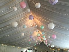 Fairylight canopy accompanied by pastel coloured hanging lanterns
