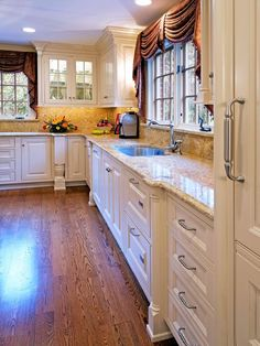 Swoon over this traditional kitchen with marble counters on HGTV.com