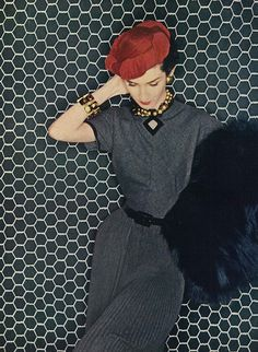 September Vogue 1952    Model is wearing a dress made of a combination of Orlon and wool called, 'Lorette' by Miliken, the black muff is from Christian Dior. Clifford C