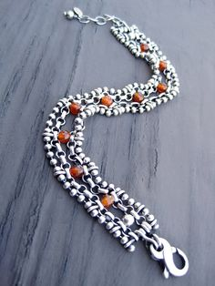 Silver bracelet Materials: sterling silver ball chain, sterling silver long and short chain, sterling silver lobster clasp, sterling silver wire, carnelian gemstone beads