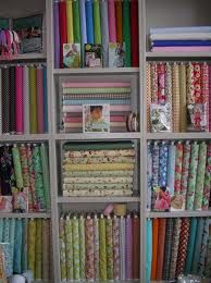 fabric storage - for those that don't have only fat quarters. i like the way some fabric is standing on end and some is laying flat