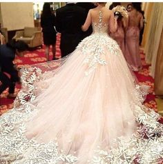 Beautiful and elegant dress! Perfect with a morganite set in rose gold and surrounded by diamonds