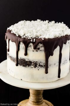A Chocolate Coconut cake that is not only a show stopper, but it tastes great as well. Made from scratch chocolate cake layered with coconut pastry cream and covered in coconut buttercream frosting is truly exceptional. A thick chocolate run glaze is. Triple Chocolate Mousse Cake, Cake Chocolate, Coconut Chocolate, Chocolate Bowls, Food Cakes, Cupcake Cakes, Coconut Frosting, Buttercream Frosting, Coconut Cakes