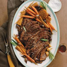 Brisket is often part of a traditional Passover meal. This rendition is oven-braised low and slow with red wine and aromatics; the meal is completed by a head of garlic and tender root vegetables.
