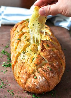 Cheese and Garlic Crack Bread (Pull Apart Bread) Cheese and Garlic Crack Bread (Pull Apart Bread) By: RecipeTin Eats Ingredients: 1 crusty loaf, preferably sourdough or Vienna ¾ cup shredded Mozzarella cheese (or other melting cheese) Garlic Butter: 100g/3.5oz unsalted butter, softened 2 garlic cloves, minced ⅜ tsp salt 1 tbsp fresh parsley, finely chopped. Target Bakery bread.