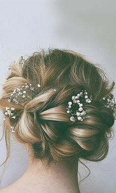 Braided Messy Bun with Baby Breath - 30 Best Wedding Bun Hairstyles - EverAfterGuide