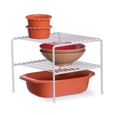 Double your storage space instantly with the Organized Living Large Double Shelf. Stack plates and bowls, cups and saucers, or cans of soups and veggies together for optimal organization and storage in the kitchen.