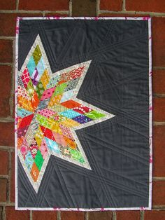 Scrappy Lone Star quilt with link to a tutorial.