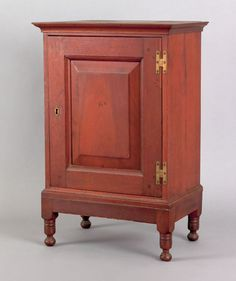 Southeastern Pennsylvania walnut spice chest, the raised panel door enclosing a ten drawer interior mounted on a sheraton cherry frame with turned feet, 26 H. x 15.75 W.