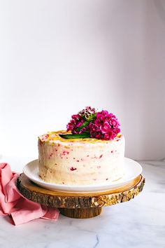 This raspberry and lemon curd chiffon cake is the stuff dreams are made of. Light, lemony cake embraces a layer of fresh raspberries and a creamy filling of whipped cream and mascarpone. More fresh raspberries are woven into the icing for a sweet, tart finish. #recipes #cakes #desserts #food #beautifulcakes