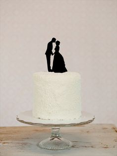 We're giving away a Free Custom Silhouette Wedding Cake Topper at Emmaline Bridel Just click on the photo for details.