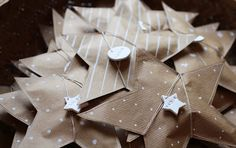 kraft paper stitched stars filled with treats and tied with string and clay tags