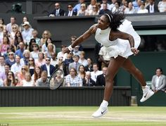 Williams plays an emphatic serve during the Wimbledon final againstKerber under the glow ...