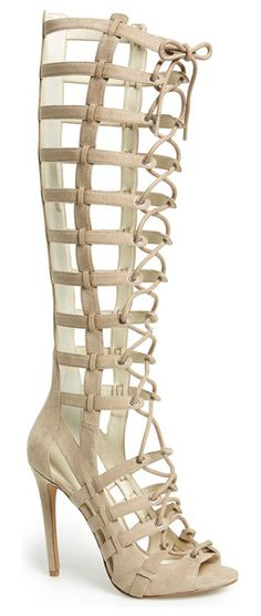 emily tall gladiator sandal by KENDALL + KYLIE. An ultra-sultry tall gladiator sandal is fitted with a cagey upper and thin laces, while a slende...