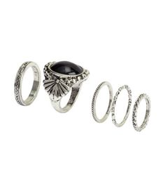 Metal rings in various sizes and designs for wear on both upper and lower parts of fingers.
