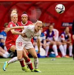 Lauren Sesselmann #10 (left) of Canada grabs a hold of Lara Dickenmann #11 of Switzerland while battling for control of the ball during the FIFA Women's World Cup Canada 2015 Round of 16 match between Switzerland and Canada June, 21, 2015 at BC Place Stadium in Vancouver, British Columbia, Canada.