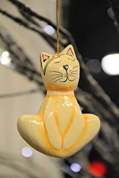 """Yoga Cat Christmas Ornament  is handmade by artisans in Indonesia out of sustainable wood. Hand carved and hand painted.  3"""" Tall."""