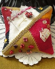 Crazy quilt pin cushion. stitch lazy daisies in an open area