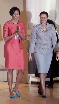 U.S. first lady Michelle Obama walks with Nelson Mandela's wife Graca Machel as she visits the Nelson Mandela Foundation in Johannesburg, South Africa, Tuesday, June 21, 2011.