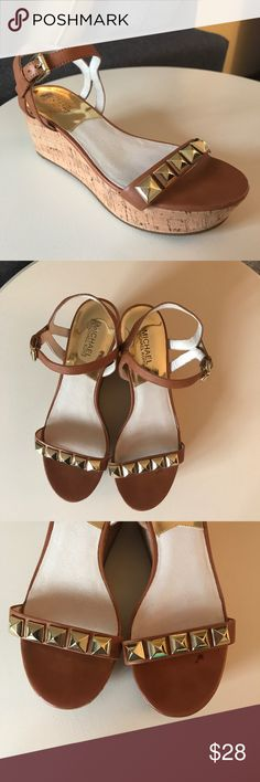 """Michael Kors cork platform tan sandals shoes gold These MICHAEL Michael Kors sandals with cork platform are super versatile and in excellent condition. Camel colored leather with gold pyramid studs and gold""""Michael Kors"""" stamped buckles. Love these but they just don't fit me right. Small mark on insole of left shoe. These are perfect for spring and summer fashions! MICHAEL Michael Kors Shoes Sandals"""