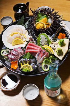 The 50 best restaurants in Baltimore including where to find this delicious sake and sea food dish! (Photo by Scott Suchman)