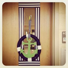 My nautical kindergarten classroom!  Wreath I made using ribbon and wooden anchor cut out I for for $2 on etsy!   I love border around everything!