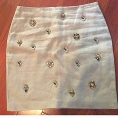 Ann Taylor skirt Fully lined tan color skirt with beautiful color stones pattern in it. Ann Taylor Skirts Midi