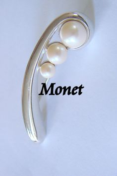 Check out this item in my Etsy shop https://www.etsy.com/listing/500828947/retro-monet-faux-pearl-designer-signed