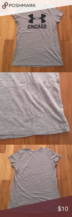 Under Armour shirt Chicago is my kind of town! This shirt was only worn a few times but the under Armour symbol faded a little in the wash! It does not have a size tag but it is a women's large. Symbol is lined in silver! Under Armour Tops