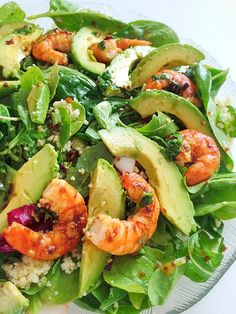 Pan fried garlic prawn on a bed of baby spinach, avocado & cous cous with orange mustard vinaigrette