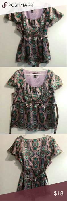 "Lane Bryant Tie-Back Top Sz. 18/20 NWOT Beautiful jewel-toned top from LB! Scoop neck, flutter sleeves and tie-back belt to customize the fit.  Super silky, lightweight  material. Bust measures 20.5"" side to side. Back of neck to hem is 27"". 7.5"" side zipper w/hook & eye.  Hit that offer button Ladies! I can't say yes unless you ask :) FRIDAY ONLY 25% off $25+ Lane Bryant Tops Blouses"