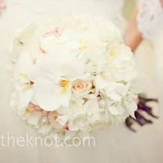 White peonies, garden roses and orchids with crystal and pearl accents.