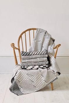 Woven throws on a vintage Ercol chair. Photographed by Yeshen Venema. Ercol Chair, Weaving Textiles, Jacquard Weave, Wicker, Accent Chairs, Cushions, Vintage, Furniture, Design