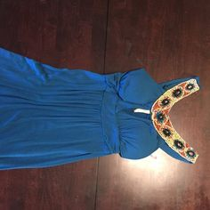 """Beautiful and Fun Teal Beadwork Dress Soft rayon material. Worn once. Padded and v-neck top. Got is super flattering. 19"""" from bottom of waist band to hem. Miuse Dresses"""