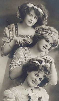 Young ladies I  think, hairstyle up ,but not quite ready for huge hats. Or ,maybe styled for an evening affair.ALady.