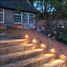 Get ready for this summer by creating a new landscape lighting design for your backyard and home. Landscape lighting comes in a variety of forms and shapes. However, the primary goals of most landscape lighting is to provide additional light to the outdoo Patio Steps, Brick Steps, Outdoor Steps, Garden Steps, Outdoor Walkway, Deck Patio, Outdoor Stair Lighting, Backyard Lighting, String Lights Outdoor